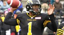 Hamilton Tiger-Cats quarterback Henry Burris steps back to throw a pass against the Montreal Alouettes in the first half of their CFL football game in Guelph on Oct. 26, 2013. The Tiger-Cats defeated the Alouettes by a score of 27-24. (FRED THORNHILL/REUTERS)