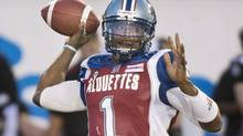 Montreal Aloutttes' quarterback Troy Smit throws a pass during second half CFL football action against the Ottawa Redblacks in Montreal, Friday, June 20, 2014. (Graham Hughes/THE CANADIAN PRESS)