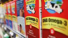 Cartons of Horizon DHA Omega-3 fortified milk are displayed for sale at a supermarket in Washington, D.C., U.S. on Thursday, July 26, 2012. The scientist at the center of a dispute over the content of advertising of Dean Foods Co.'s Horizon fortified organic milk said she's satisfied by the company's confirmation that it expects to stop referring to her work on the product's cartons. Photographer: Rich Clement/Bloomberg (Rich Clement/Bloomberg)