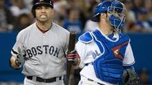 Boston Red Sox centre fielder Jacoby Ellsbury reacts after striking next to Toronto Blue Jays catcher J.P. Arencibia during eighth inning AL baseball action in Toronto on Thursday, August 15, 2013. (Nathan Denette/THE CANADIAN PRESS)