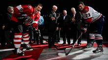 NHL Hockey Hall of Fame member Gordie Howe, centre, drops the puck during a ceremonial faceoff for Vancouver Giants' Wes Vannieuwenhuizen, left, and Lethbridge Hurricanes' Graham Hood, right, during an 85th birthday ceremony before the WHL hockey game in Vancouver B.C., on Friday March 1, 2013. Howe turns 85 on March 31. (DARRYL DYCK/THE CANADIAN PRESS)