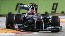 Mercedes Formula One driver Michael Schumacher of Germany drives during the qualifying session of the Singapore F1 Grand Prix at the Marina Bay street circuit in Singapore September 22, 2012. (PABLO SANCHEZ/REUTERS)
