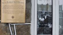 A photo of late baseball player Jackie Robinson and his wife Rachel sits in a window beside a newly unveiled plaque outside the former residence of Jackie Robinson in Montreal. Jackie Robinson and his wife Rachel lived in Montreal in 1946 while he played for one season with the Montreal Royals before joining the majors. (CHRISTINNE MUSCHI/CHRISTINNE MUSCHI/REUTERS)