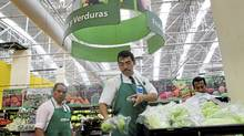FILE -- Workers during their shift at a Wal-Mart store in Mexico City, March, 29, 2012. Recently, Wal-Mart's stock fell almost 5 percent on April 23, as investors reacted to a bribery scandal at the retailer's Mexican subsidiary and a report that an internal investigation was quashed at corporate headquarters in Arkansas. (JOSH HANER/NYT)