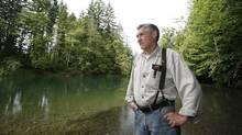 Joe Saysell, a now-retired local fishing guide, stands along the banks of the Cowichan River near Lake Cowichan. (Deddeda Stemler For The Globe and Mail)