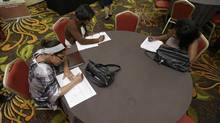 Applicants for a nurse's assistant job at the Cleveland Career Fair in Independence, Ohio. (TONY DEJAK/AP)