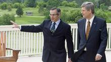 Prime Minister Stephen Harper walks with local MP Tony Clement before making an announcement in Huntsville, Ont., June 19, 2008. Huntsville hosted the 2010 G8 meetings at the Deerhurst resort. (Adrian Wyld/THE CANADIAN PRESS)