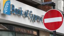 A no entry sign is seen outside a branch of Bank of Cyprus UK, in central London March 18, 2013. European bank shares fell more than 2 percent on Monday as a plan by Cyprus to seize money from bank deposits raised fears that savers elsewhere may not be safe and the euro zone may be plunged back into crisis. Customers with deposits at branches of the bank in the UK are not affected by the levy. (ANDREW WINNING/REUTERS)