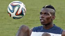 France's national soccer team player Paul Pogba controls the ball during a training session at the Botafogo soccer club's Santa Cruz stadium in Ribeirao Preto, 336 km (208 miles) northwest of Sao Paulo, June 17, 2014. (Charles Platiau/Reuters)