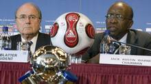 File photo: Joseph Blatter, left, president of FIFA, listens to Jack Warner at the FIFA U-20 World Cup Friday, July 20, 2007 in Toronto. (CP PHOTO/Paul Chiasson) (Paul Chiasson/CP)