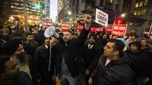 Taxi drivers protest against Uber during a demonstration at Bay and Queen Streets in Toronto on Dec. 9, 2015. (Mark Blinch For The Globe and Mail)