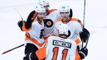 Philadelphia Flyers' Claude Giroux, left, celebrates his game winning overtime goal against the Ottawa Senators with teammates. (Sean Kilpatrick/THE CANADIAN PRESS)