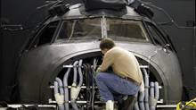 A technician works on a simulator at CAE Inc., in Montreal (Christinne Muschi For The Globe and Mail)