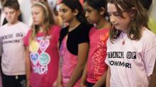 Alison Barrett, right, joins her schoolmates at Bowmore Road Junior and Senior Public School in Toronto, and students across the country, in a moment of silence to remember bullying victim Amanda Todd on Friday, October 19, 2012. (Michelle Siu for The Globe and Mail)