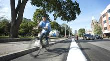 On Sherbourne Street, a prototype bike lane, separated from traffic by a narrow band of concrete. (Kevin Van Paassen/The Globe and Mail)
