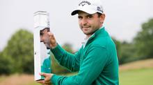 Paraguay's Fabrizio Zanotti poses with the trophy after he won the BMW International Open golf tournament (Rolf Vennenbernd/AP)