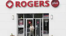 Rogers Communications Inc. has recorded a slowdown in its wireless data revenue growth rate in its past two quarterly reports as more consumers chose cheaper data plans. (Adrian Wyld/The Canadian Press)