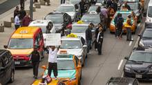 Taxi drivers protest against Uber in Toronto on June 1. (Mark Blinch For The Globe and Mail)