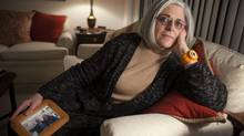 """Judy Gross is photographed in her apartment along with some family photos. Ms. Gross's husband Alan was arrested while working for the US AID in Havana in 2009. She has been working to free him ever since. """"I am devastated by his appearance,"""" Judy Gross wrote in the statement following her return to the United States. """"While his spirit remains strong, I fear he is not going to survive this terrible ordeal."""" (Dennis Drenner for the Globe and Mail)"""