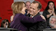 New Democratic Party Member of Parliament Peggy Nash (left) and party president Brian Topp embrace following the NDP leadership debate in Ottawa. (BLAIR GABLE/Blair Gable/Reuters)