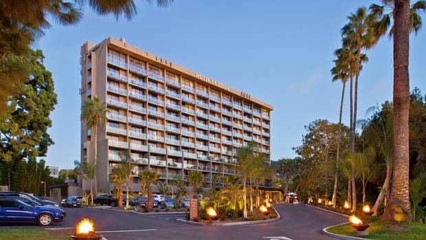 Arrive at Hotel La Jolla at night and you'll drive up a torch-lit path lined with palm trees. (Darren Edwards)
