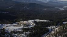 An aerial view of the South Island Aggregates site where tonnes of contaminated soil is dumped everyday near a sensitive watershed, in the distance is Shawnigan Lake, B.C., January 6, 2016. (CHAD HIPOLITO For The Globe and Mail)