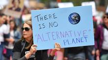 People hold signs during the March for Science in San Francisco, California on April 22, 2017. (JOSH EDELSON/AFP/Getty Images)
