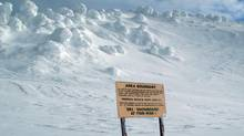 An avalanche warning is posted near the top of a ski run in B.C. (Jacques Boissinot/THE CANADIAN PRESS)