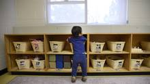 Toddlers (18 to 30 months old) are photographed in the Infant Room at the Sir Samuel B. Steele YMCA on June 23 2014. (Fred Lum/The Globe and Mail)