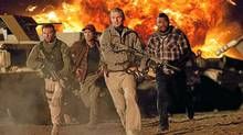 "The A-Team in action: (from left) Face (Bradley Cooper), Murdock (Sharlto Copley), Hannibal (Liam Neeson) and B.A. (Quinton ""Rampage"" Jackson). (Doug Curran)"