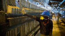 A worker at the Chemaf copper, cobalt processing plant in the city of Lubumbashi, in the Democratic Republic of the Congo (DRC) on May 9, 2012. An obvious source of Africa's new might is the surge in commodity prices. (John Lehmann/The Globe and Mail)