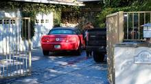 An unknown visitor arrives at a gated house in the Woodland Hills section of Los Angeles on Tuesday, Jan. 24, 2017. Monica Sementilli, 45, and Robert Baker, 55 were arrested June 16 for the death of Fabio Sementilli, an internationally known hairdresser and beauty company executive.