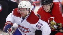 Ottawa Senators' Colin Greening fights Montreal Canadiens' David Desharnais for control of the puck during the third period of their NHL hockey game in Ottawa January 30, 2013. (Reuters)