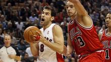 Toronto Raptors guard Jose Calderon goes to the basket past Chicago Bulls forward Joakim Noah, right, during the first half of their NBA basketball game in Toronto, November 11, 2009. (MIKE CASSESE)