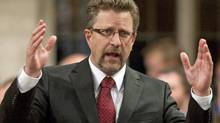 Infrastructure Minister Chuck Strahl responds during Question Period in the House of Commons on Sept. 20, 2010. (Adrian Wyld/THE CANADIAN PRESS)
