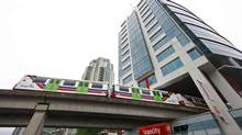 The Skytrain travels underneath Vancity Credit Union headquarters in Vancouver. (Jeff Vinnick For The Globe and Mail)