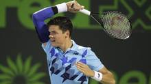 Milos Raonic, of Canada, returns the ball to Rafael Nadal, of Spain, during the Sony Open tennis tournament, Thursday, March 27, 2014, in Key Biscayne, Fla. (Luis M. Alvarez/AP)
