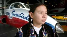 Kenzie Wilson of Clear Lake, MB poses for a photograph next to a Canadair CT-114 Tutor (Snowbirds) at the Museum of Aviation in Ottawa on November 21, 2011. (Dave Chan/Dave Chan for The Globe and Mail)