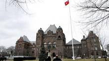 The Ontario provincial flag flies over Queen's Park in Toronto. (Deborah Baic/The Globe and Mail)