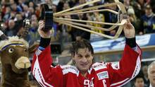 Team Canada's captain Ryan Smyth lifts the winner's trophy after final match between Team Canada and HC Davos at the 86th Spengler Cup ice hockey tournament, in Davos, Switzerland, Monday, Dec. 31, 2012. (Salvatore Di Nolfi/AP)