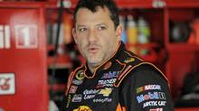 NASCAR Sprint Cup Series driver Tony Stewart speaks with crew members during practice for the Daytona 500 qualifying at Daytona International Speedway in Daytona Beach, Florida, in this file photo taken February 16, 2013. (BRIAN BLANCO/REUTERS)