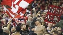 Toronto FC fans cheer on their team prior to the first leg of the MLS Eastern Conference final against the Montreal Impact at the Olympic Stadium in Montreal, Tuesday, November 22, 2016. (Graham Hughes/THE CANADIAN PRESS/)