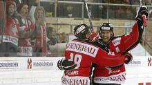 Joel Perrault, right, and Jeremy Williams of Team Canada celebrate after he scored during their match against HC Vitkovice at the Spengler Cup in Davos, Switzerland on Monday. (ARND WIEGMANN)