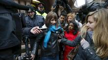 Actress Lucy DeCoutere, above, a complainant in the case against former Canadian radio host Jian Ghomeshi, faces a media scrum outside the the courthouse in Toronto after a judge announced <252>the not-guilty verdict. (MARK BLINCH/REUTERS)