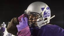Western Mustangs defensive lineman Rupert Butcher secures his helmet during practice in this Nov. 12, 2013 file photo. The six-foot-five, 327-pound player was dominant in the one-on-one competition at the CFL combine on March 13, 2016. (GEOFF ROBINS For The Globe and Mail)