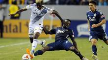 Los Angeles Galaxy forward Gyasi Zardes is defended by Vancouver Whitecaps midfielder Gershon Koffie during the second half at StubHub Center. The Galaxy won 1-0. (USA TODAY Sports)