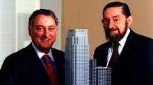 Paul Reichmann, right, and Citigroup's Sandy Weill with a model of Citi's headquarters building at Canary Wharf, London, in this 1999 file photo. (/AP)