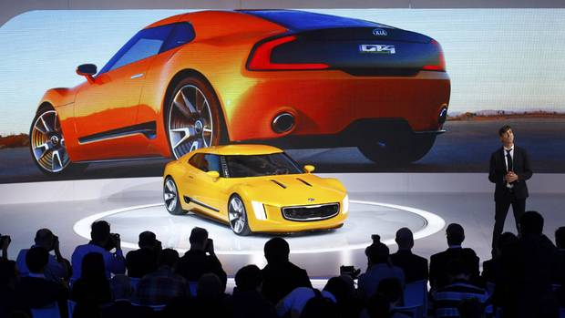 Kia Chief Designer Tom Kearns speaks as the GT4 Stinger concept car is displayed during the press preview day of the North American International Auto Show in Detroit, Michigan January 13, 2014. (JOSHUA LOTT/REUTERS)