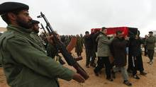 A funeral is held in the Libyan town of Assabia for military commander Ezzedine al-Ghool, who was reportedly tortured to death by fighters in Gharyan, a rival city, Jan. 19, 2012. (ISMAIL ZITOUNY/REUTERS/ISMAIL ZITOUNY/REUTERS)