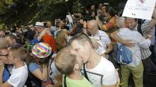 Activists hug and kiss each other in front of the Russian embassy in Brussels on Sept. 8, 2013. 'Kiss in' rallies were held across the globe Sunday to protest Russia's anti-gay laws. (Yves Logghe/AP)